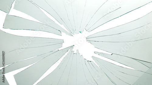 Broken and cracked glass with hole on a white background Fototapete