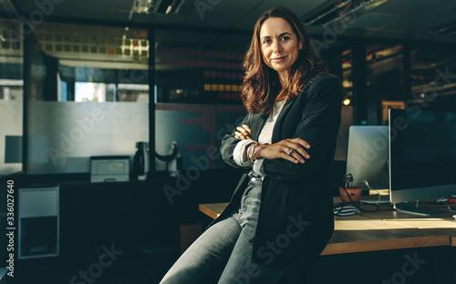 Mature businesswoman sitting on her desk