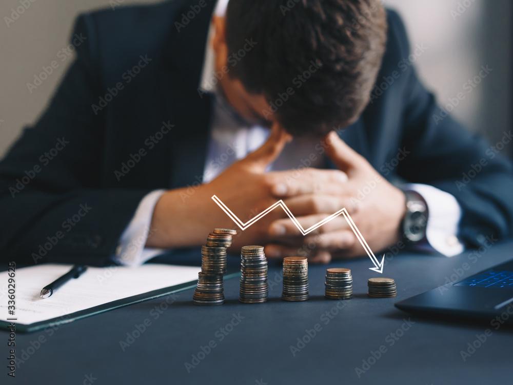 Fototapeta Depressed businessman lost his business. Destroyed businessman. Concept of business loss, bankruptcy and crisis.