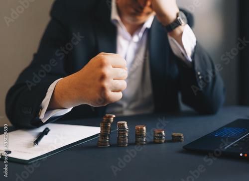 Fototapeta Depressed businessman lost his business. Destroyed businessman. Concept of business loss, bankruptcy and crisis.  obraz