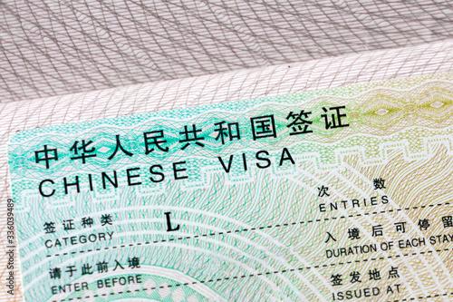 Photo Chinese visa in the passport, close up. Travel Asia.