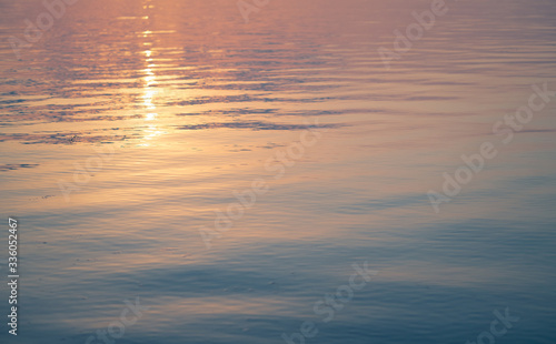 surface of the water, the sea of the lake in a gentle sunset color, retro tinted Canvas Print