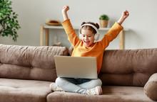 Girl Celebrating Victory In Video Game.