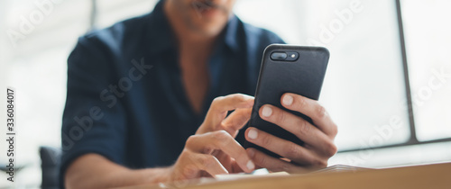 Close-up photo of male hands with smartphone