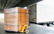 Large Shipment Pallet Goods Load With A Truck, Package Box, Cargo Export, Road Freight Delivery Transport, Warehouse Industrial Service Logistics.