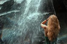 Woman At The WaterfallWoman Wi...