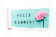 Hello Summer Text And Pink Gerbera Flower On Mint Background. Paper Hole With Torn Edges. Hello Summer Concept