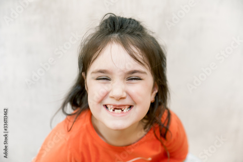 Valokuva defocused funny close up face portrait of Little agressive naughty girl with ang
