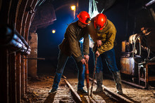 Miners In The Process Of Working With Tools In Their Hands. Coal Mine. Two Miners In The Mine. Copy Space