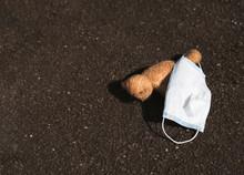 Teddy Bear Lying On Street Wit...