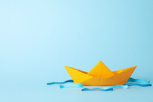 Paper Boat And Waves On Blue B...