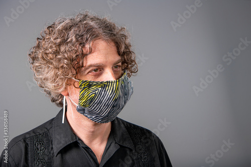 Leinwand Poster Portrait of a middle aged man wearing a homemade cloth mask during the Covid-19 outbreak