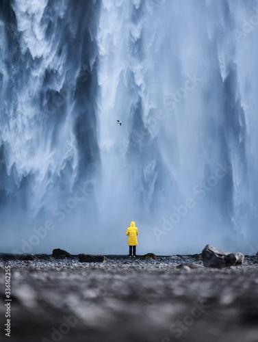Tourist on the Skogafoss waterfall background Canvas Print