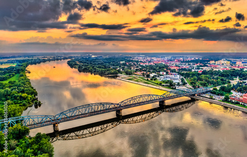 Jozef Pilsudski Bridge across the Vistula River at sunset in Torun, Poland