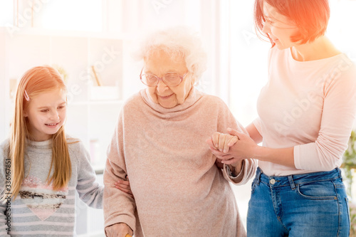 Photo Three generation of women supporting each other