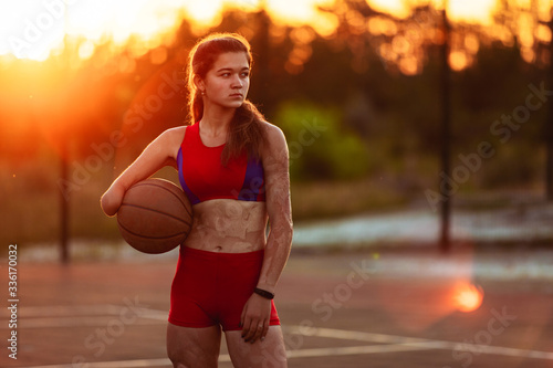 Young woman athlete with an amputated arm and burns on her body Canvas Print
