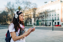 Young Woman With Headphones Us...