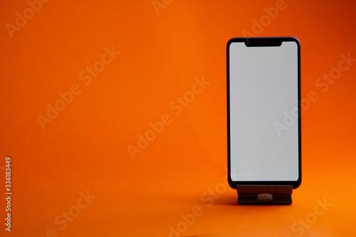 Fototapeta Black digital smartphone with white empty screen mock up obraz