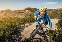 Man Riding Mountainbike On Dus...
