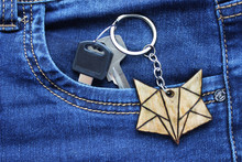 Two Keys With Wooden Fox-shaped Keychain In Jeans Pocket