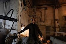 Factory Employee Pulling Cruci...