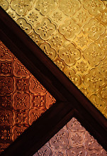 Pattern Of Geometric Mosaic Texture On The Glass In Three Colors