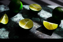 Close Up Of Lime Slices On Table