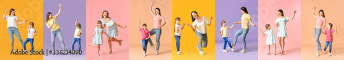 Fotografia Happy mother and her little daughter dancing against color background