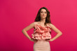 canvas print picture - beautiful girl standing in elegant dress isolated on pink