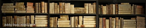 Fotografie, Obraz antique books on old wooden shelf.