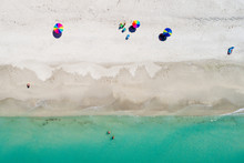 Anonymous People At The Beach From Above