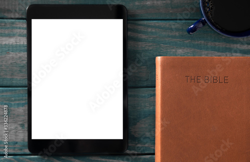 Photo A Tablet with a Bible for LIve Streaming Church Services or Bible Study