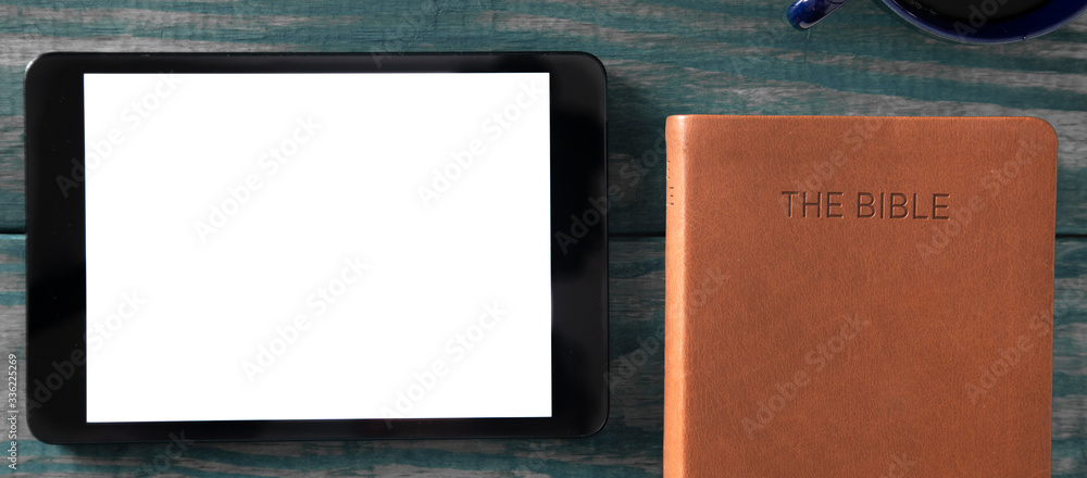 Fototapeta A Tablet with a Bible for LIve Streaming Church Services or Bible Study