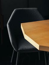Black Chair Near Irregular Table