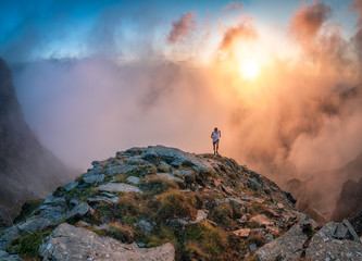 trailrunner in front of sunset clouds