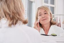 Mature Woman Removing Makeup