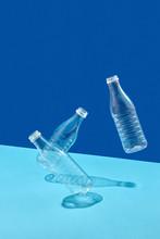 Flying Plastic Bottles On Blue Background