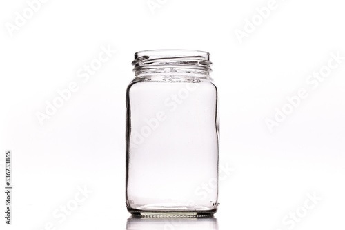 Closeup shot of an empty glass jar isolated on a white background Slika na platnu