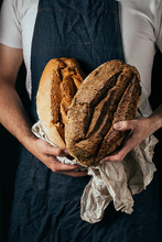 Man Holding A Bread