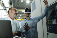 Two Men With VR Glasses In Factory