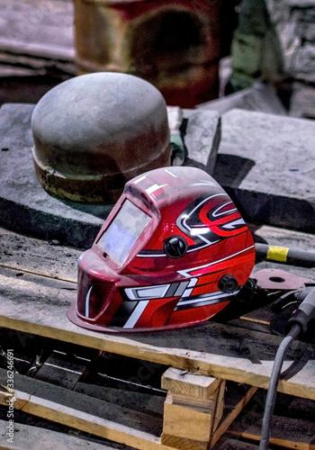 welding helmet on a wood pallet Canvas Print