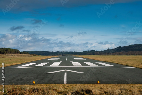 Small airport asphalt runway with markings for landings Wallpaper Mural