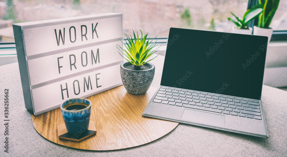 Fototapeta Working from home remote work inspirational social media lightbox message board next to laptop and coffee cup for COVID-19 quarantine closure of all businesses.