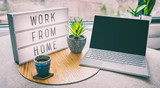 Working from home remote work inspirational social media lightbox message board next to laptop and coffee cup for COVID-19 quarantine closure of all businesses. - 336255662