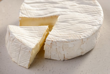 Close View On Brie Cheese. Big Piece Cut From A Wheel