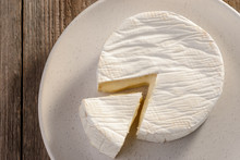Top View On French Camembert Cheese On Plate