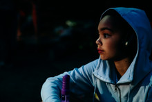 Girl In Hoodie With Face Lit B...