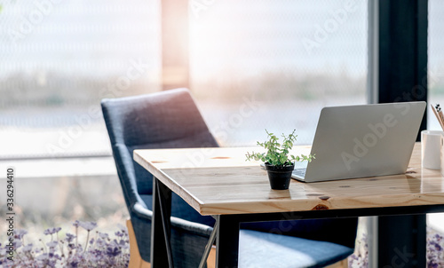 Fotografia Workplace concept with laptop on wooden top table.