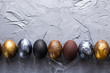 canvas print picture - Holidays, traditions and Easter concept - Dark stylish easter eggs on grey background with copyspace.
