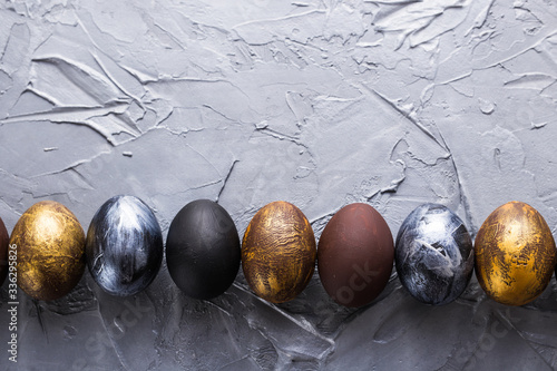 Holidays, traditions and Easter concept - Dark stylish easter eggs on grey background with copyspace Canvas